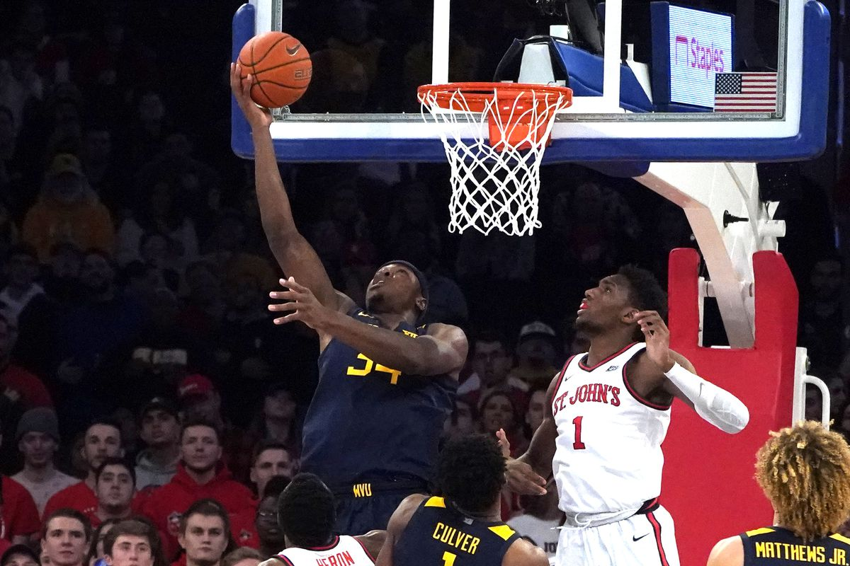 West Virginia Mountaineers Forward Oscar Tshiebwe shoots a reverse layup during the second half of the game between the West Virginia Mountaineers and the St. John's Red Storm on December 7, 2019, at Madison Square Garden in New York, NY.