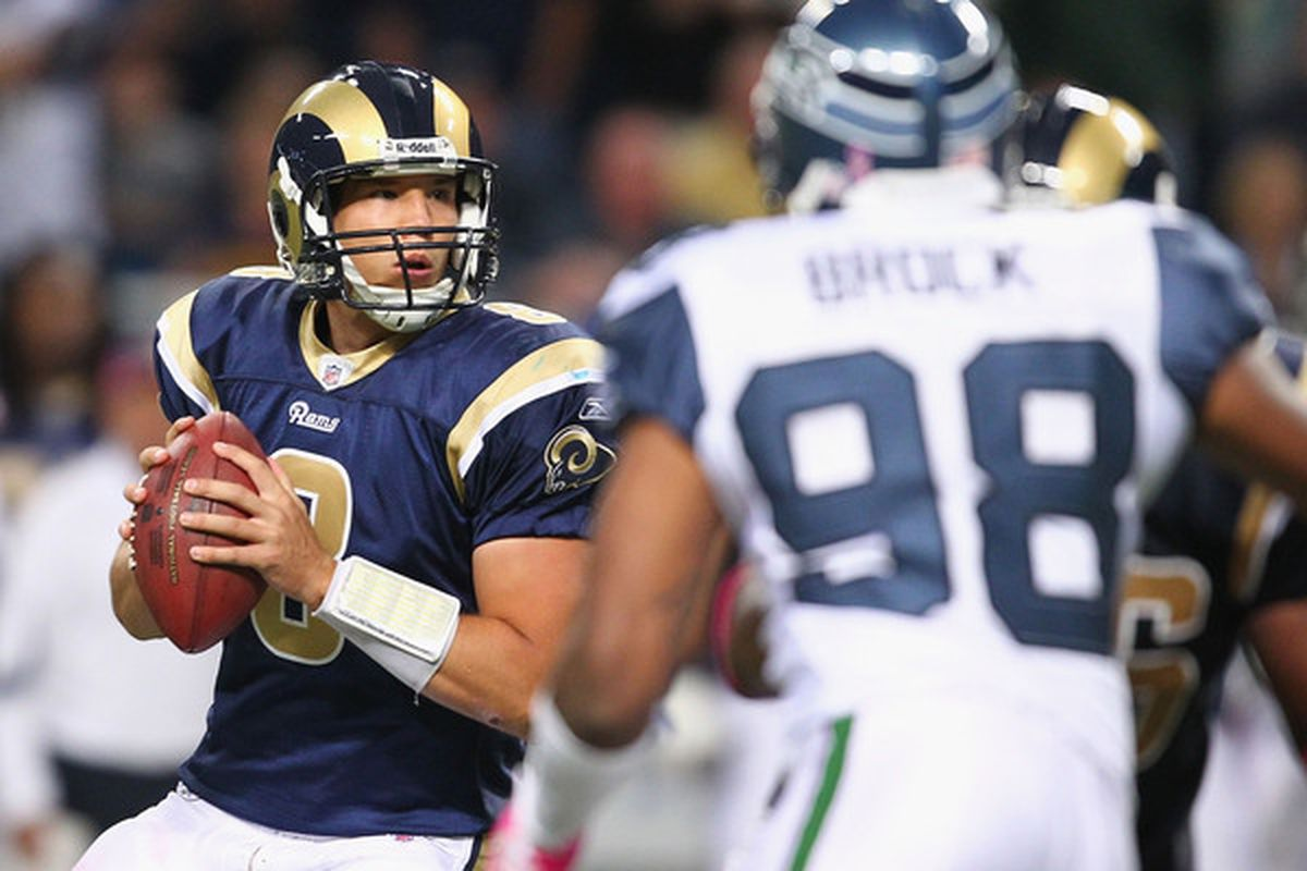 ST. LOUIS - OCTOBER 3: Sam Bradford #8 of the St. Louis Rams looks to pass against the Seattle Seahawks at the Edward Jones Dome on October 3 2010 in St. Louis Missouri.  The Rams beat the Seahawks 20-3.  (Photo by Dilip Vishwanat/Getty Images)