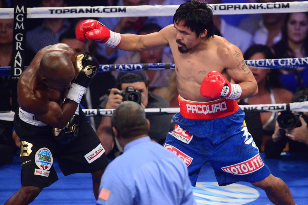 Jun. 9, 2012; Las Vegas, NV, USA; Manny Pacquiao (right) against Timothy Bradley Jr during a welterweight championship bout at the MGM Grand Garden Arena. Mandatory Credit: Mark J. Rebilas-US PRESSWIRE
