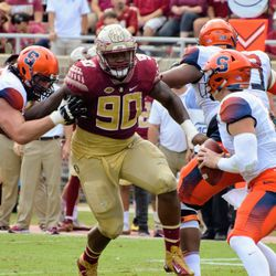 RS JR DT Demarcus Christmas crashes through the Syracuse offensive line.