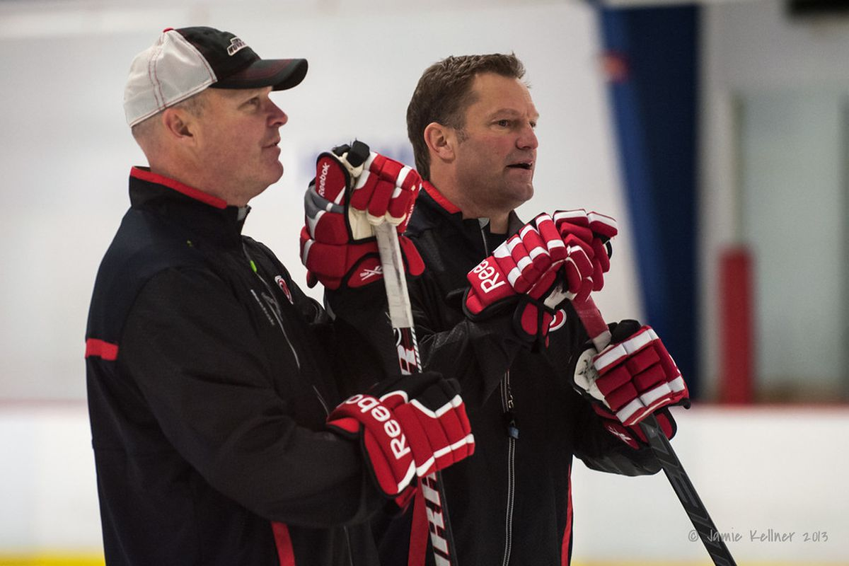 Head coach Kirk Muller, left, and assistant coach John MacLean, right, were both fired by the Hurricanes Monday. Assistant coach Dave Lewis was also fired, and goaltending coach Greg Stefan was reassigned to the team's pro scouting department.
