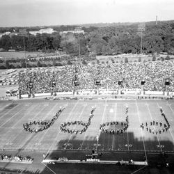 <strong>19??- Marching band forming four half notes in Doak Campbell Stadium</strong>