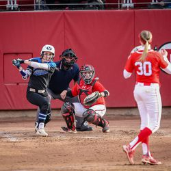BYU outfielder Rylee Jensen (2) hits a triple in the second inning off Utah starting pitcher Hailey Hilburn (30) as the University of Utah hosts Brigham Young University at Duke Stadium in Salt Lake City on Wednesday, April 18, 2018.