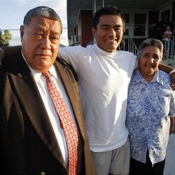 Patrick Palau poses with his grandpa Salesi and grandma Lavinia Monday, Sept. 24, 2012. Patrick has signed to play for BYU when he returns from an LDS Mission.