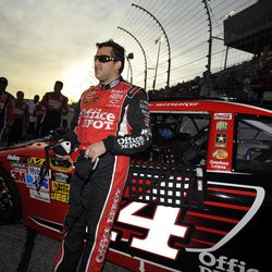 Tony Stewart waits by his car before the NASCAR Sprint Cup Series auto race at Atlanta Motor Speedway, Sunday, Sept. 2, 2012, in Hampton, Ga.
