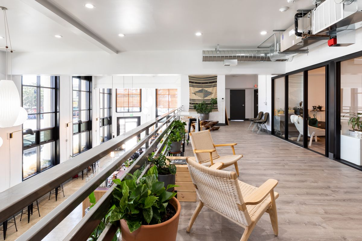 The second floor at Red Bay Headquarters in Oakland, with seats and potted plants.