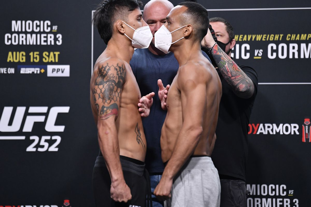 In this handout image provided by UFC, (L-R) Opponents TJ Brown and Danny Chavez face off during the UFC 252 weigh-in at UFC APEX on August 14, 2020 in Las Vegas, Nevada.
