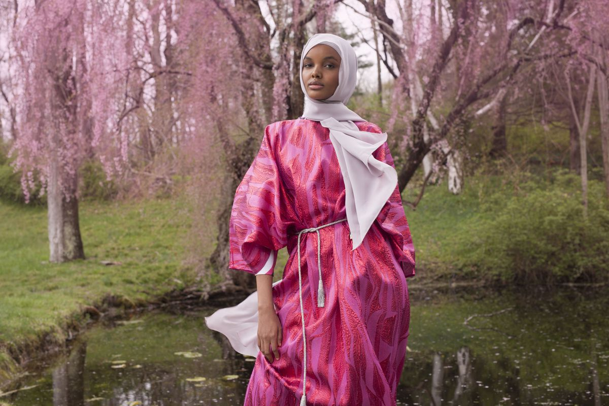 Halima Aden in a pink Kaftan and scarf.