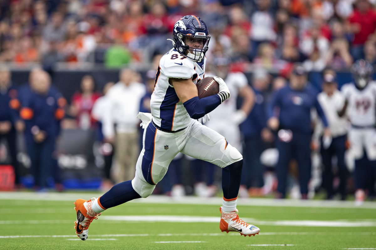 Noah Fant of the Denver Broncos runs with the ball after catching a pass during the first half of a game against the Houston Texans at NRG Stadium on December 8, 2019 in Houston, Texas.