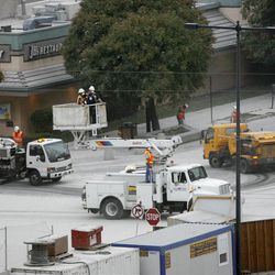 Workers clean the dust and dirt from the roads and Trax train lines at the corner of South Temple and West Temple after the old Key bank building was demolished in downtown Salt Lake City by explosives. August 17, 2007.