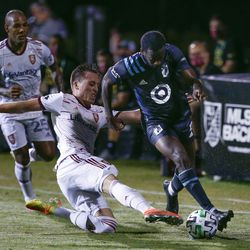 Minnesota United midfielder Kevin Molino, right, battles Real Salt Lake forward Corey Baird (10) as midfielder Everton Luiz (25) pursues during the first half of a soccer match in Kissimmee, Fla., Friday, July 17, 2020.