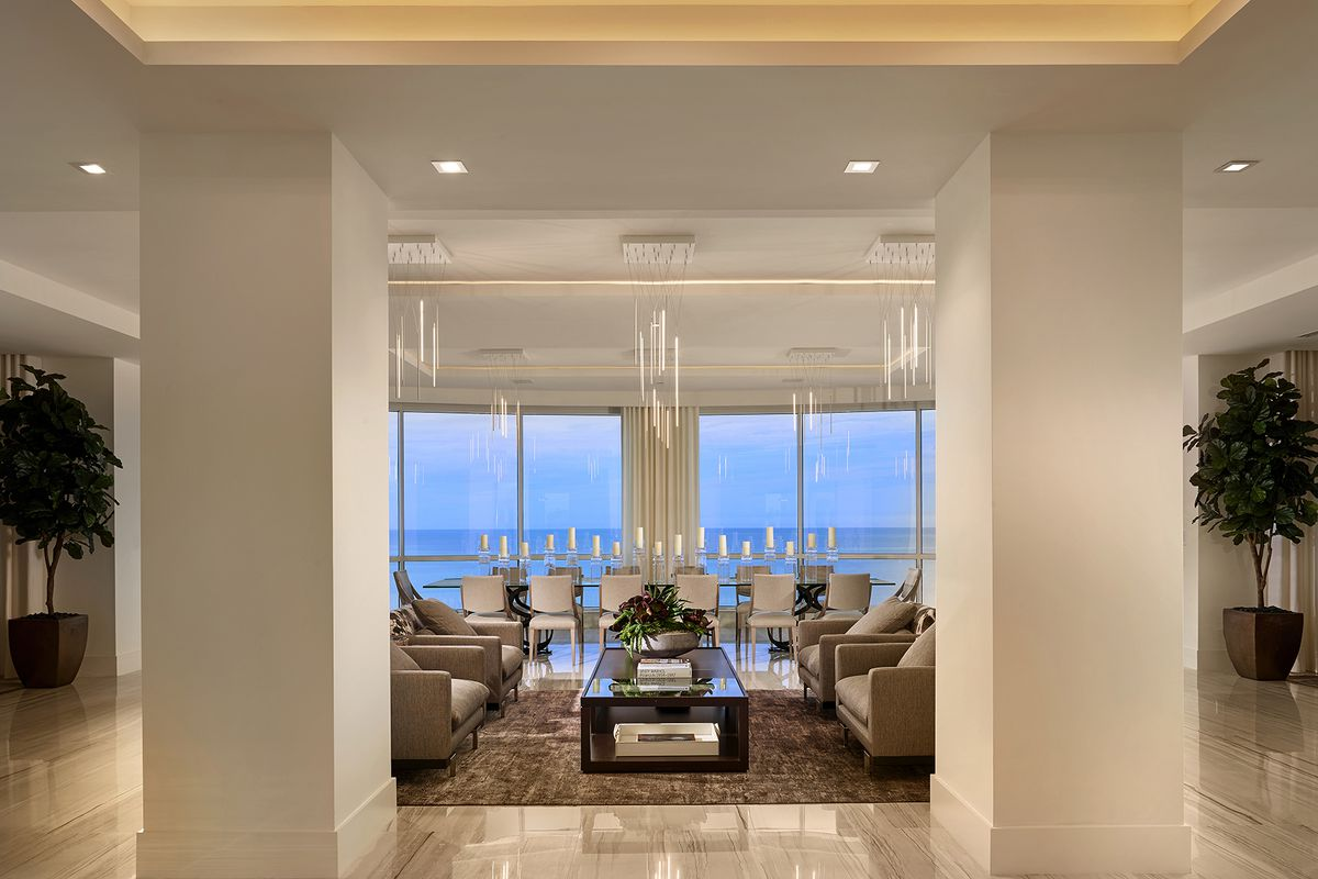 A Naples penthouse living room withe the ocean in the background