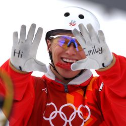 USA's Jeret Peterson waves at the camera with a message for teammate Emily Cook before his second jump at the men's aerials qualification at Deer Valley Resort on Saturday, Feb. 16, 2002. Cook was on the U.S. Olympic freestlye team but was sidelined with an injury. Peterson took her spot on the team and qualified for the finals on Monday with a score of 237.39.