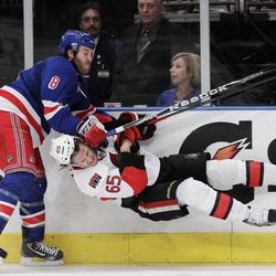 New York Rangers' Brandon Prust (8) and Ottawa Senators' Erik Karlsson (65) collide during the second period of Game 2 of a first-round NHL hockey playoff series Saturday, April 14, 2012, in New York.