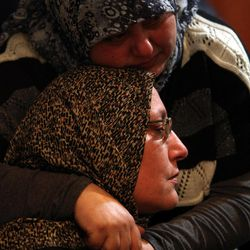 A woman is comforted as she mourns for her son Ali Shaaban, a television cameraman working for Al-Jadeed TV who was shot dead on the Lebanon-Syria border, at their home in Beirut, Lebanon, Monday, April 9, 2012. Shaaban was killed when the channel's film crew came under fire in the border area of Wadi Khaled, the channel's head of news said.