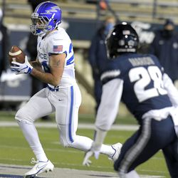 Air Force running back Kadin Remsberg (24) carries the ball for a 21-yard touchdown against Utah State during the first half of an NCAA college football game Thursday, Dec. 3, 2020, in Logan, Utah.