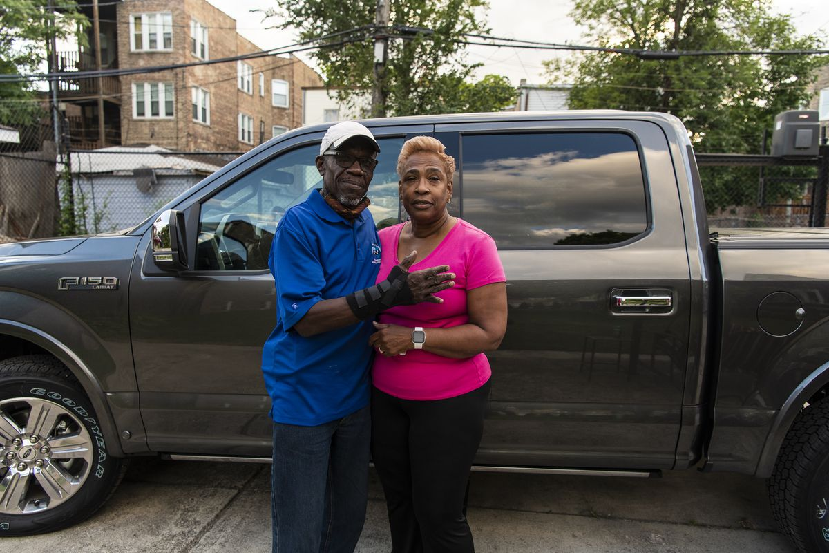 Arthur Turner Sr., left, a former member of the Illinois House of Representatives on Tuesday stands next to his wife, Rosalyn, and the new truck he was going to buy when he was arrested over the weekend.