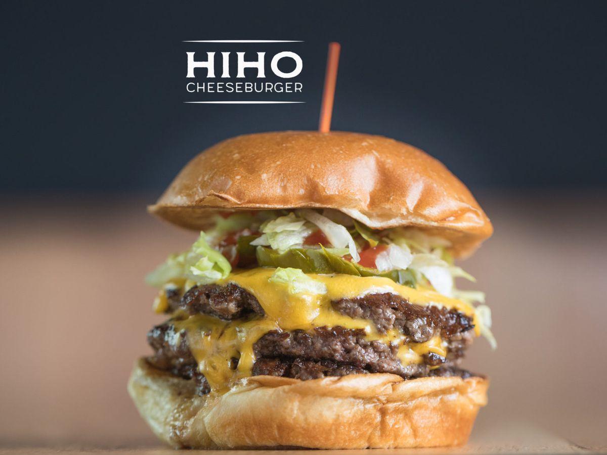 A juicy HiHo Cheeseburger sits as a product shot.