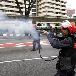 Riot police fire tear gas at demonstrators during an anti-Internal Security Act (ISA) protest near the National Mosque in Kuala Lumpur, Malaysia, Saturday.
