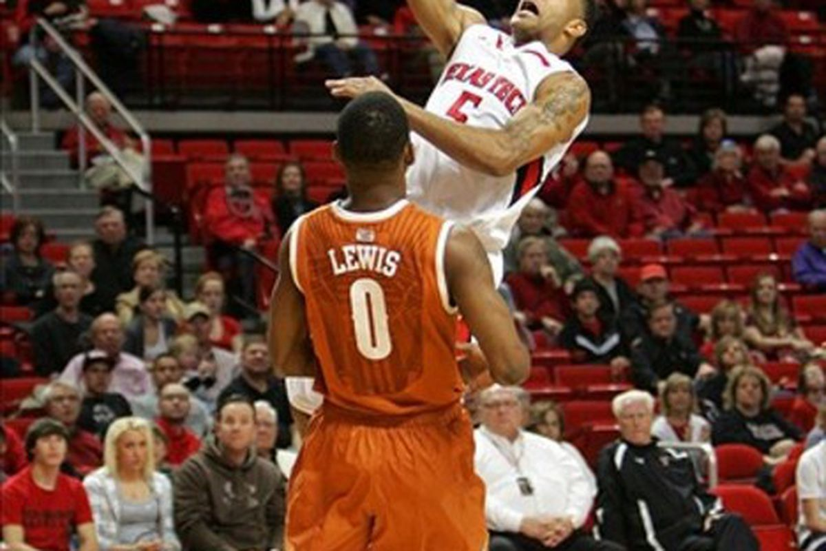 Feb 25, 2012; Lubbock, TX,  USA; Texas Tech Red Raiders guard Javarez Willis (5) goes up for a lay-up against Texas Longhorns guard Julien Lewis (0) in the first half at the United Spirit Arena. Mandatory Credit: Michael C. Johnson-US PRESSWIRE