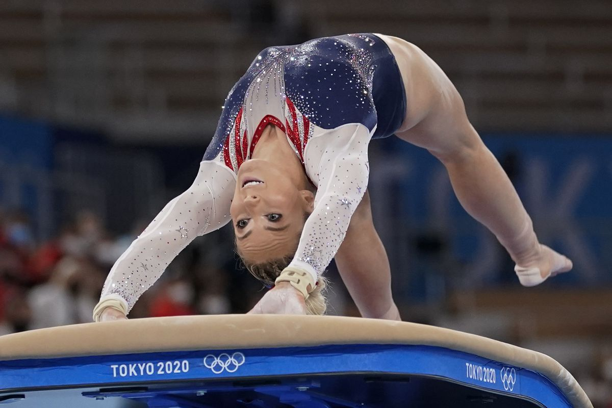 Gymnast Mykayla Skinner is twisted in a backbend with her arms on the vault as she performs during the artistic gymnastics women's apparatus final at the 2020 Summer Olympics, Sunday, Aug. 1, 2021, in Tokyo, Japan.
