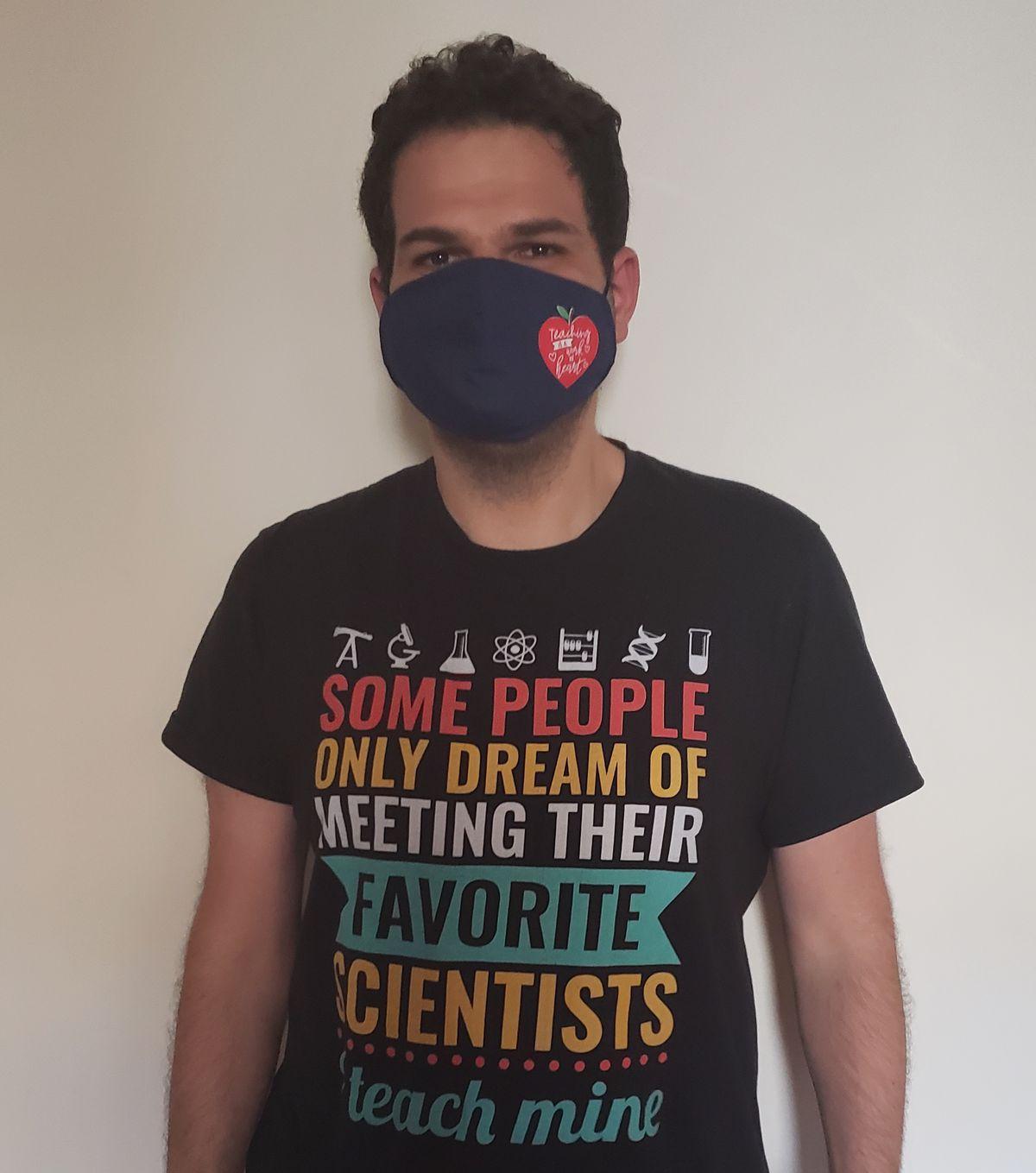 Konstantyn Goldin wears a black T-shirt about teaching science.