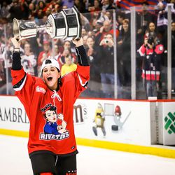 Metropolitan Riveters forward Rebecca Russo celebrates with the Isobel Cup.