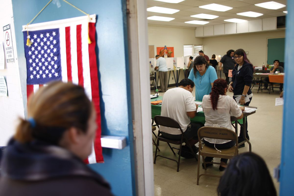 People vote at a polling place in the heavily Latino East LA area during the US presidential election on November 6, 2012, in Los Angeles, California.