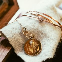 """Monogrammed necklace, <a href=""""http://blancamonrosgomez.com/collections/necklaces/products/monogrammed-necklace"""">$620</a>"""
