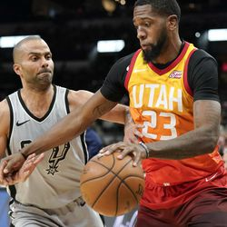 Utah Jazz's Royce O'Neale (23) drives around San Antonio Spurs' Tony Parker during the second half of an NBA basketball game Friday, March 23, 2018, in San Antonio. San Antonio won 124-120 in overtime. (AP Photo/Darren Abate)