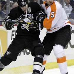 Pittsburgh Penguins' Evgeni Malkin (71) works in the corner against Philadelphia Flyers' Braydon Coburn (5) in the second period of an NHL hockey game in Pittsburgh Saturday, April 7, 2012. The Penguins won 5-2.