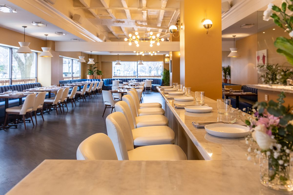 A chef's counter with leather seats.