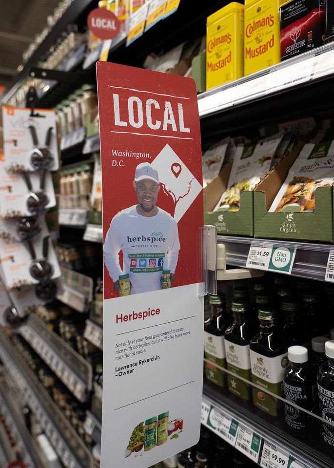 A sign in Whole Foods advertises products from Herbspice, one of the Black-owned businesses the grocery store found through a partnership with Market 7
