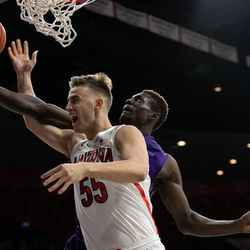 Arizona's Jake Desjardins (55) is fouled during the Arizona-Western New Mexico University game in McKale Center on October 30 2018 in Tucson, Ariz.