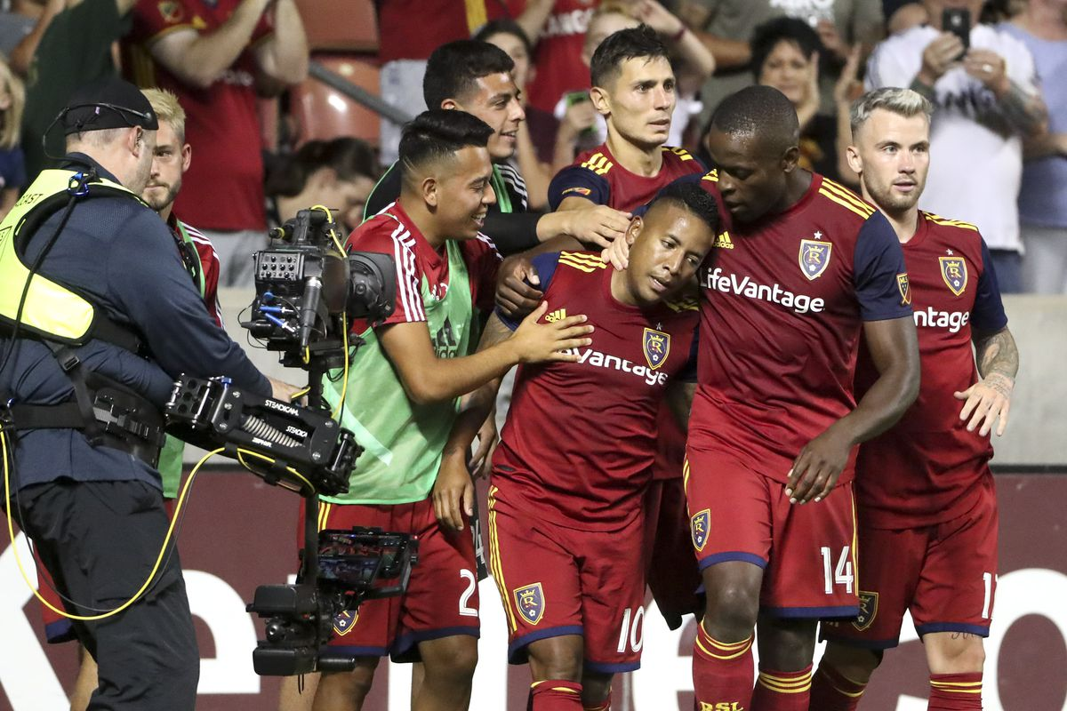 Real Salt Lake forward Joao Plata (10) is mobbed by his teammates after scoring on a penalty kick during a soccer match against the Colorado Rapids at Rio Tinto Stadium in Sandy on Saturday, Aug. 24, 2019.