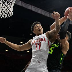 Arizona's Ira Lee (11) muscles his way towards an offensive rebound during the Arizona-Baylor game in McKale Center on December 15 in Tucson, Ariz.