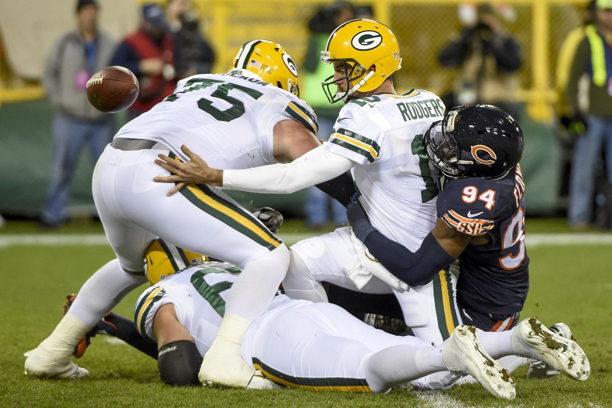 Here's a pic of Bryan Bulaga shooting a football out of his ass.