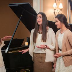 """From left to right, Seli, Desi, and Ari Miller are shown at the video shoot for """"Glorioso,"""" a Spanish translation of the song """"Glorious,"""" which was made popular by the film """"Meet the Mormons."""""""