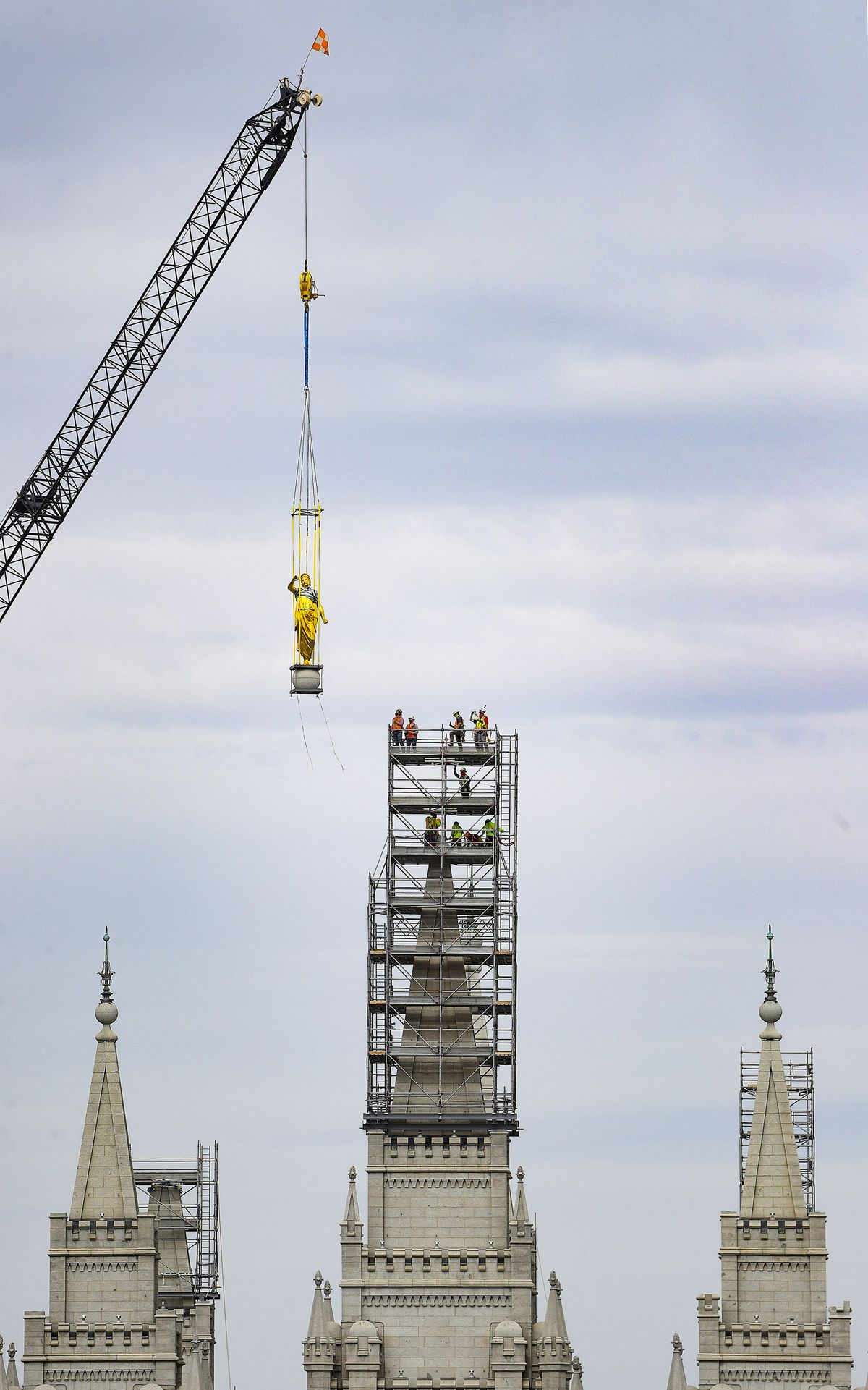 The Angel Moroni statue is temporarily removed by crane from atop the Salt Lake Temple of The Church of Jesus Christ of Latter-day Saints in Salt Lake City on Monday, May 18, 2020.