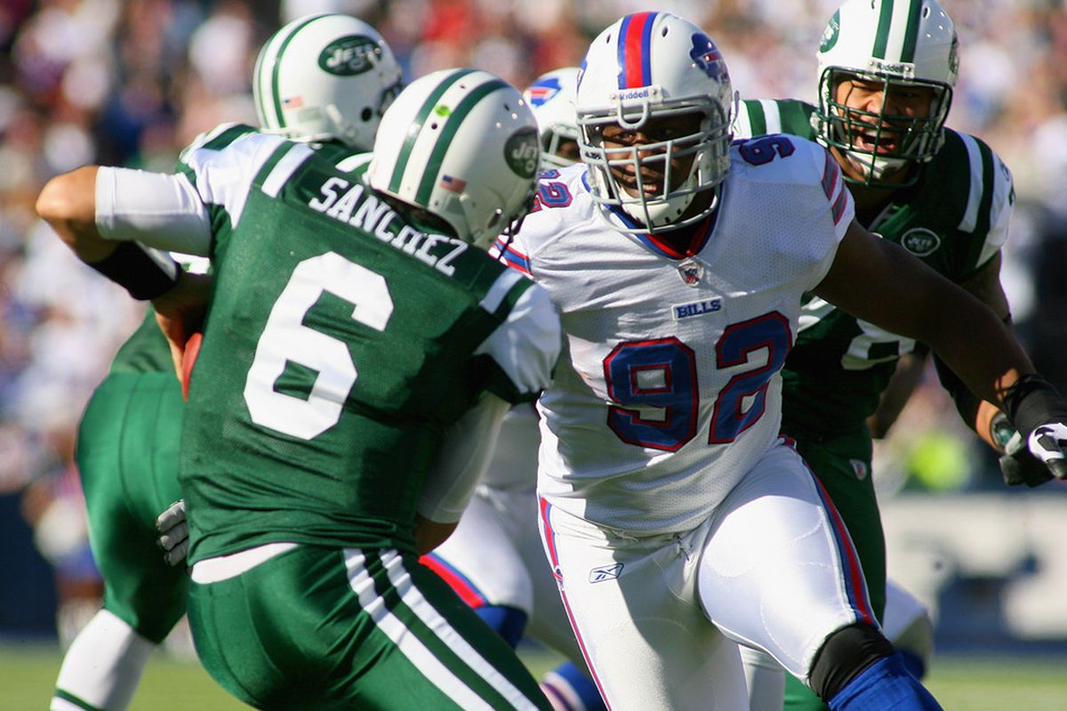 ORCHARD PARK, NY - NOVEMBER 06:  Alex Carrington #92 of the Buffalo Bills rushes in to sack Mark Sanchez #6 of the New York Jets  at Ralph Wilson Stadium on November 6, 2011 in Orchard Park, New York.  (Photo by Rick Stewart/Getty Images)