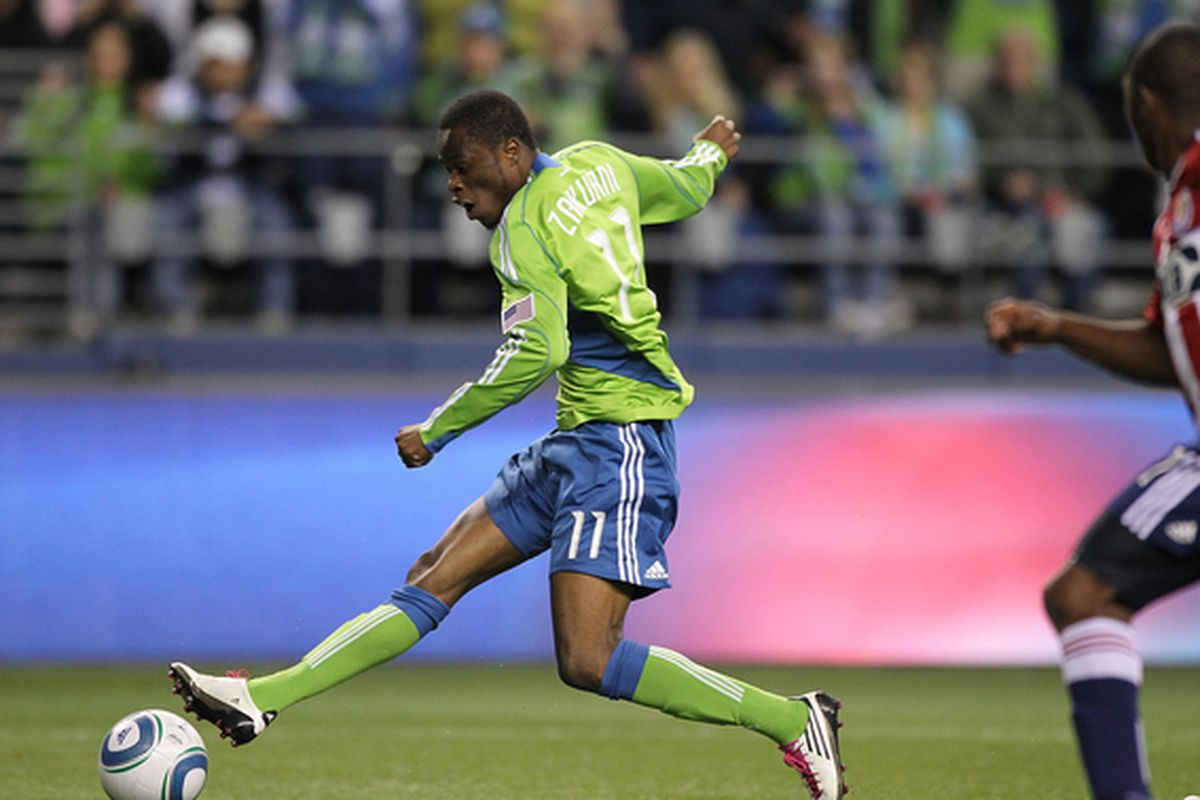 SEATTLE - OCTOBER 15:  Steve Zakuani #11 of the Seattle Sounders FC scores a goal in the first half against Chivas USA on October 15 2010 at Qwest Field in Seattle Washington. (Photo by Otto Greule Jr/Getty Images)
