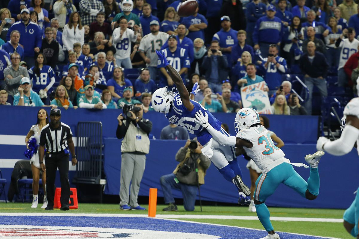 Indianapolis Colts wide receiver Chester Rogers tries to make a game winning catch in the end zone against Miami Dolphins cornerback Chris Lammons with under a minute to go in the game at Lucas Oil Stadium.