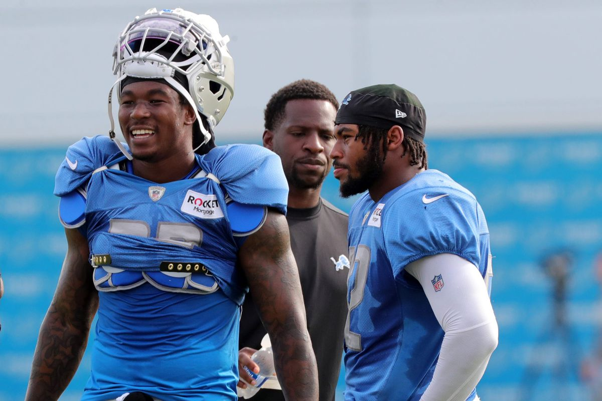 Lions running backs Jamaal Williams, left, and D'Andre Swift watch the action during training camp on Tuesday, August 3, 2021, in Allen Park.