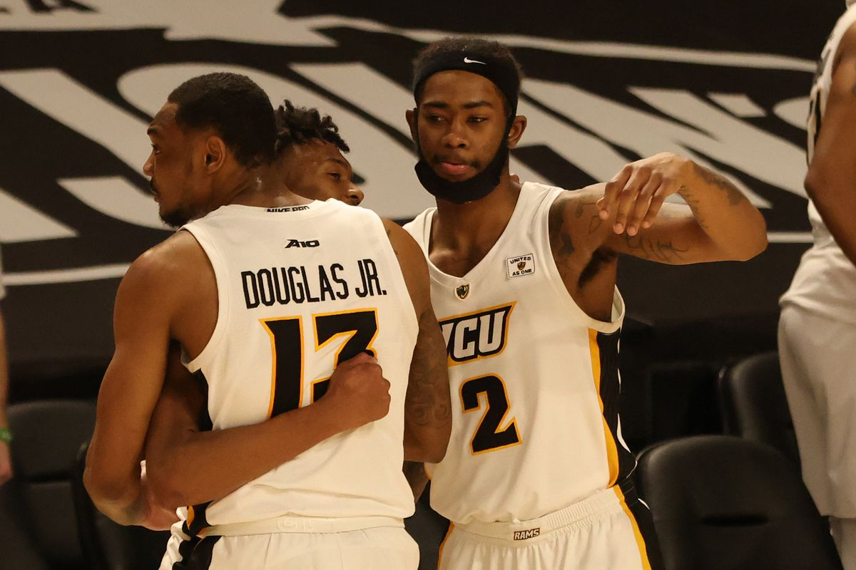 VCU Rams players celebrates after their game against the Richmond Spiders at Stuart C. Siegel Center.