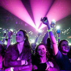 Fans smile and cheer at the Imagine Dragons Tulsa, Okla. concert.