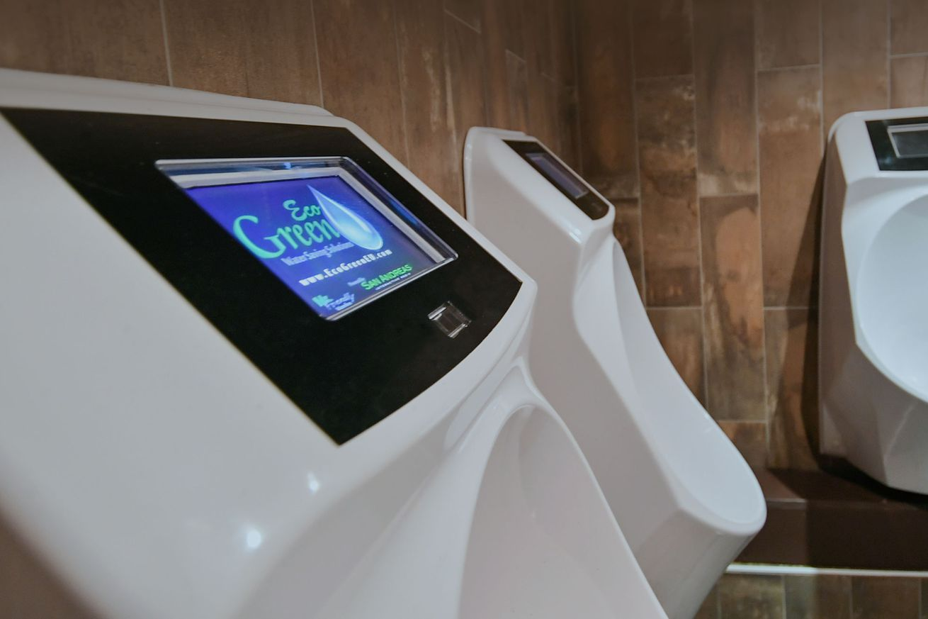 this smart urinal will show you ads while you pee