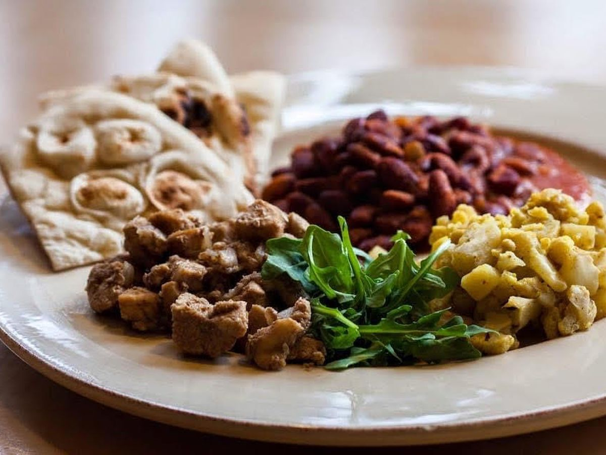 A plate of Indian food, including naan and lentils, at Makeda and Mingus in Greenwood