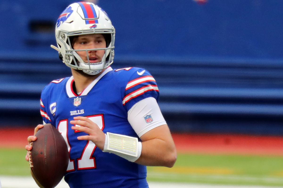 Josh Allen #17 of the Buffalo Bills makes a pass against the Miami Dolphins during the first quartrer at Bills Stadium on January 03, 2021 in Orchard Park, New York.