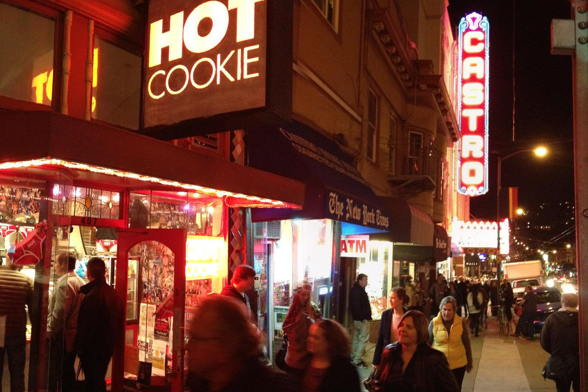 Exterior of the Castro bakery Hot Cookie, with the sign lit up at night