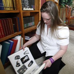 Jennifer Graves looks through a scrapbook at her home in West Jordan on Monday, April 30, 2012.